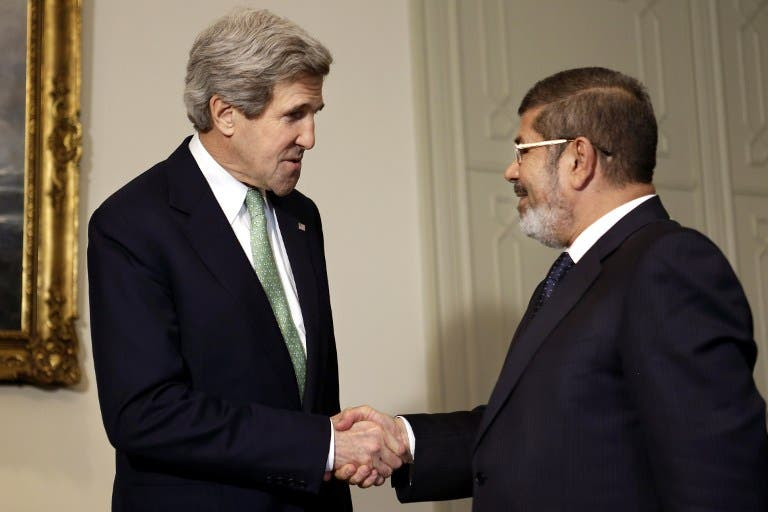 US Secretary of State John Kerry meets the Egyptian President Mohammed Morsi in March (AFP Photo)