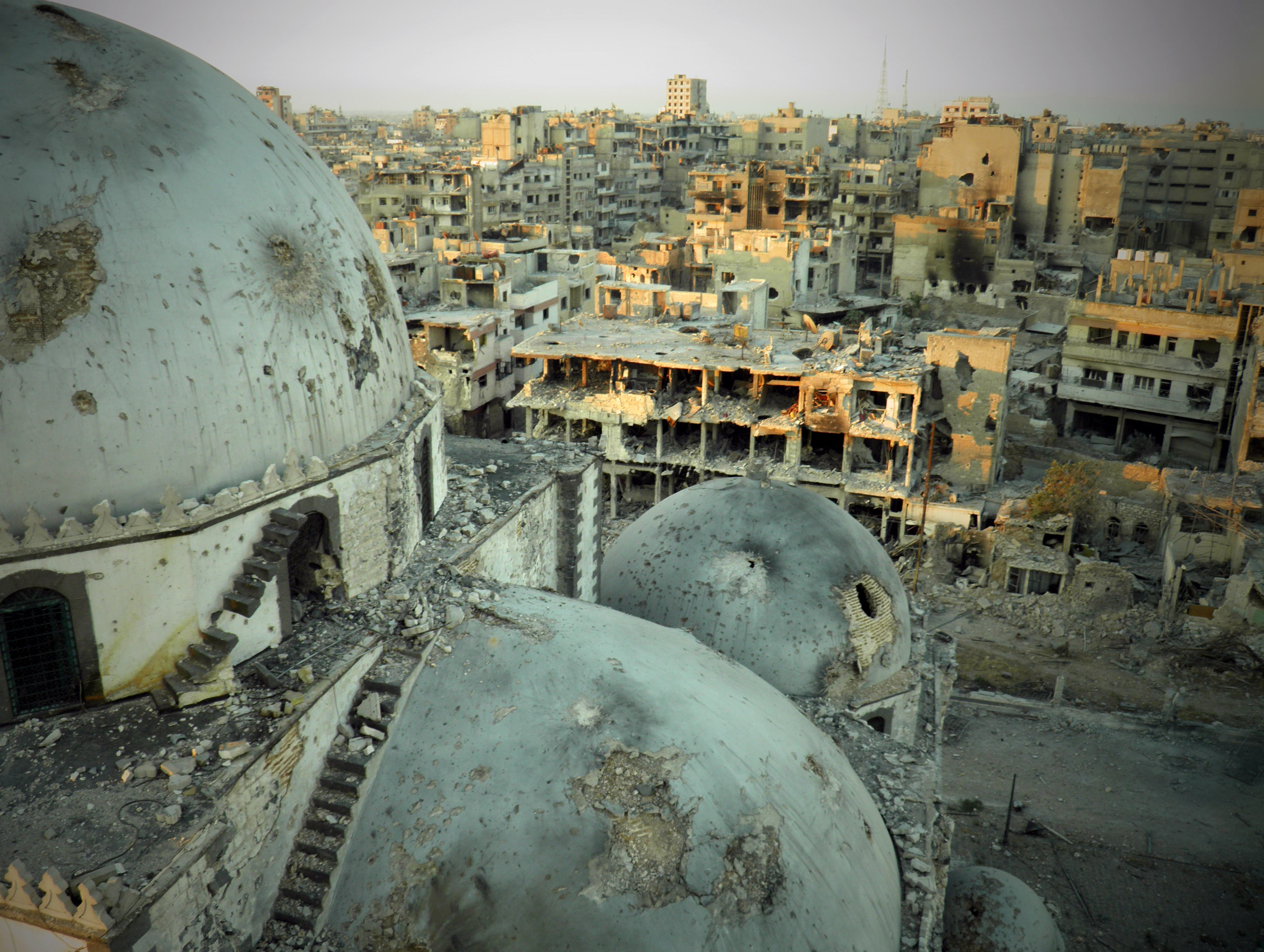 A handout image allegedly shows the Khaled bin Walid mosque, whose mausoleum has been partially destroyed in the al-Khalidiyah neighborhood of the central Syrian city of Homs. (AFP/HO/SHAAM NEWS NETWORK)