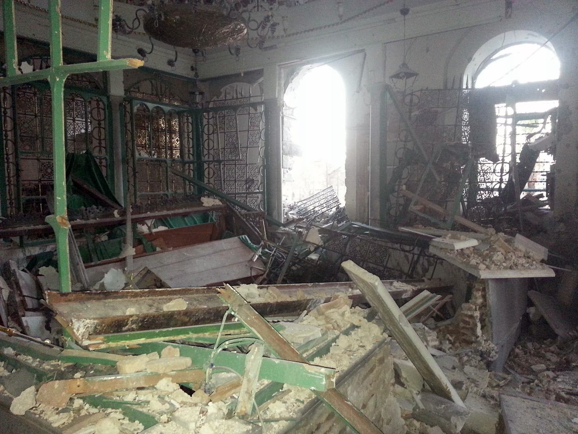 A handout image released by the Syrian opposition's Shaam News Network on July 22, 2013, allegedly shows the partially destroyed mausoleum of the Khaled bin Walid mosque (AFP/HO/SHAAM NEWS NETWORK)