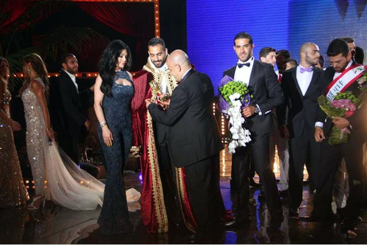 The moment Ayman Moussa was crowned as Mr. Lebanon alongside singer Haifa Wehbe. (Image: Facebook)