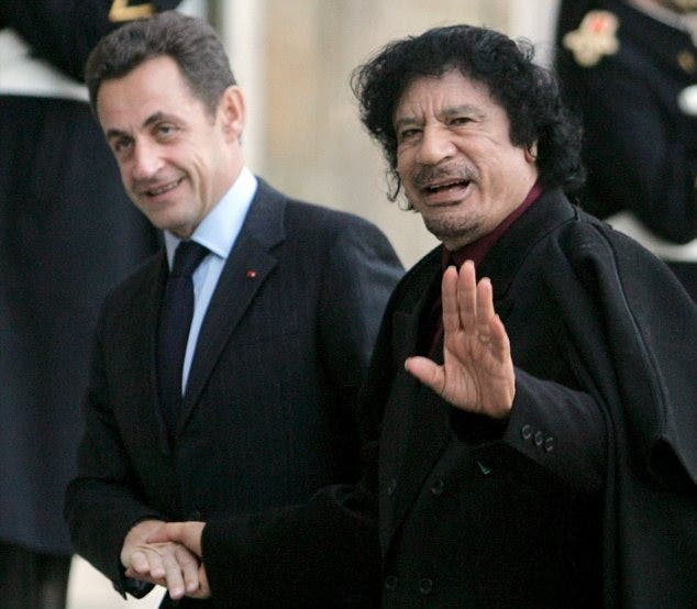 Nocolas Sarkozy cozies up with the late Gaddafi