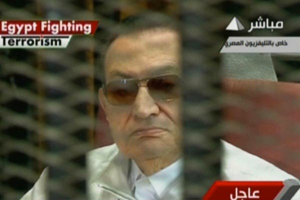 An image grab taken from the Egyptian state TV shows Egypt's ousted dictator Hosni Mubarak sitting in the defendants' cage on August 25, 2013 during his trial in Cairo. (AFP/Egyptian TV)
