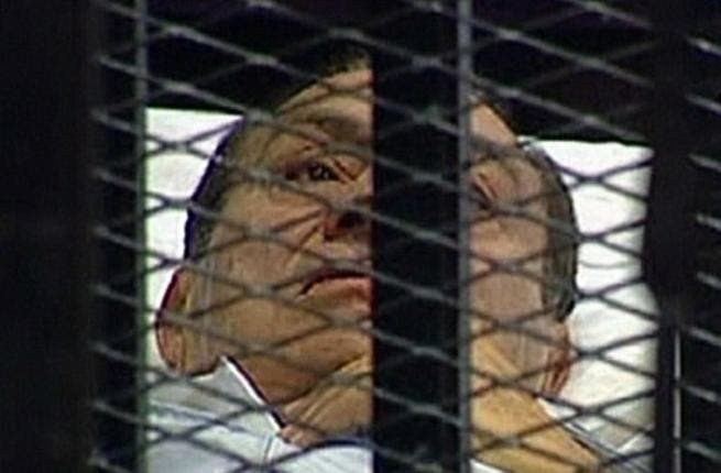 Speculation had arisen over whether the Pharaoh himself, Mubarak, would be in attendance at his own trial: He came in earlier today on a stretcher, and stayed in the 'docks' that way in his invalid condition.