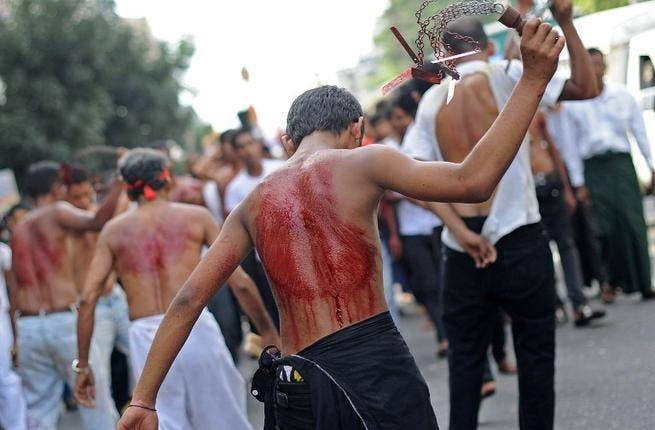 A Shia boy flogs himself during the Ashura celebrations in Myanmar.