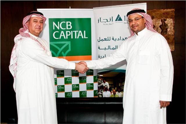 Jawdat Al Halabi, CEO of NCB Capital and Nael Samir Fayez, CEO of Injaz-Saudi Arabia after signing the agreement