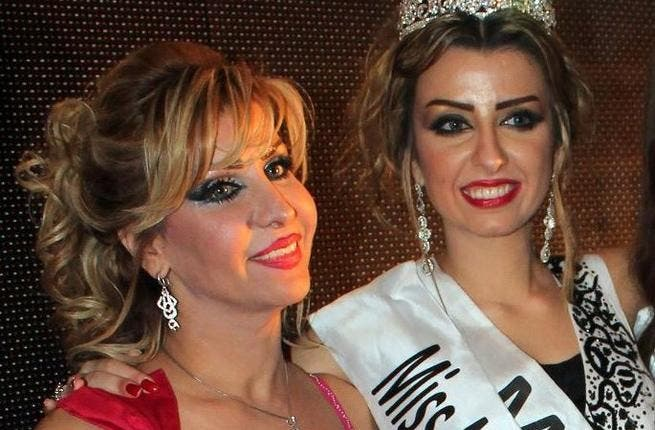 Nadine Fahad (R) is crowned queen.