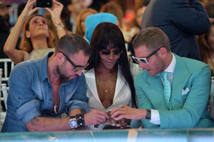 Supermodel Naomi Campbell and fashion designers D Squared sitting in front row at a fashion show on Dubai Mall's catwalk. (Image: Samir Hussein/Getty Images for Vogue and The Dubai Mall)