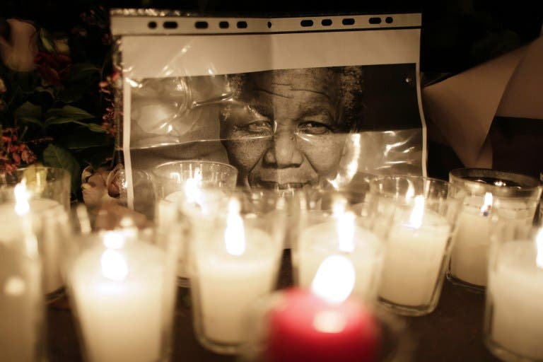 The UAE will host a heartfelt memorial to the late and great Nelson Mandela on Wednesday. Flowers are layed on December 6, 2013, on the ground in front of the South African Embassy in Paris. (AFP)