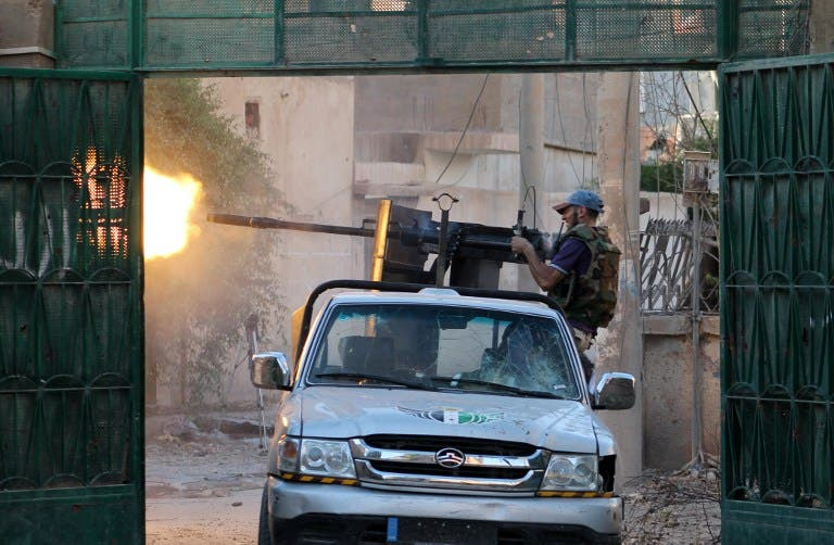 A Syrian rebel fighter fires from a truck during clashes with forces loyal to the regime in the eastern Syrian town of Deir Ezzor on August 1, 2013. (AFP)
