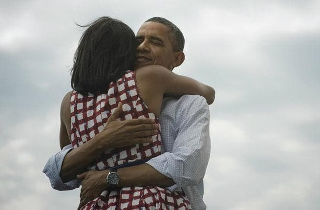 President Obama hugs his wife Michelle