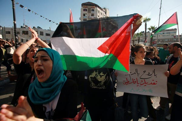 Protesters shout slogans during a demonstration against the Israeli government on July 15, 2013 near the West Bank town of Ramallah. (AFP)
