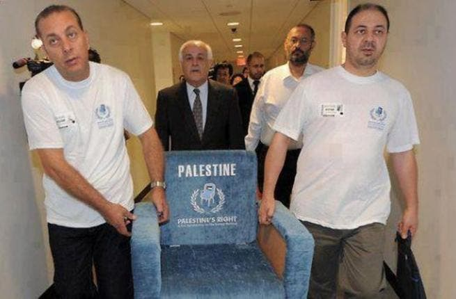 Members of the Palestinian delegation to the UN carry a chair similar to those used in the UN General Assembly.