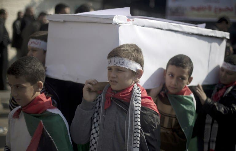 Palestinian children hold a protest - complete with fake coffins - in solidarity with the starving and besieged residents of Yarmouk. (AFP/File)