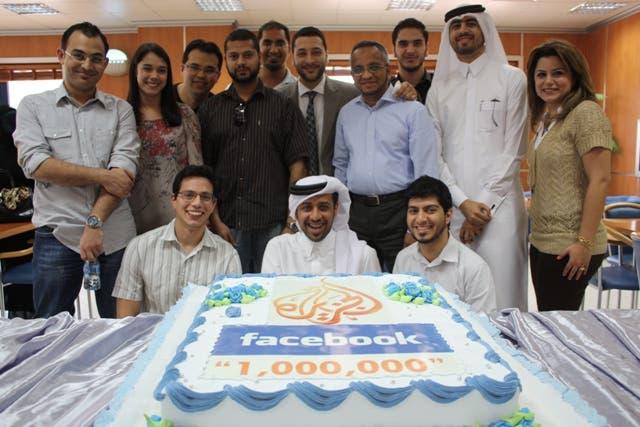 Al Jazeera's social media team celebrating with a specially branded cake