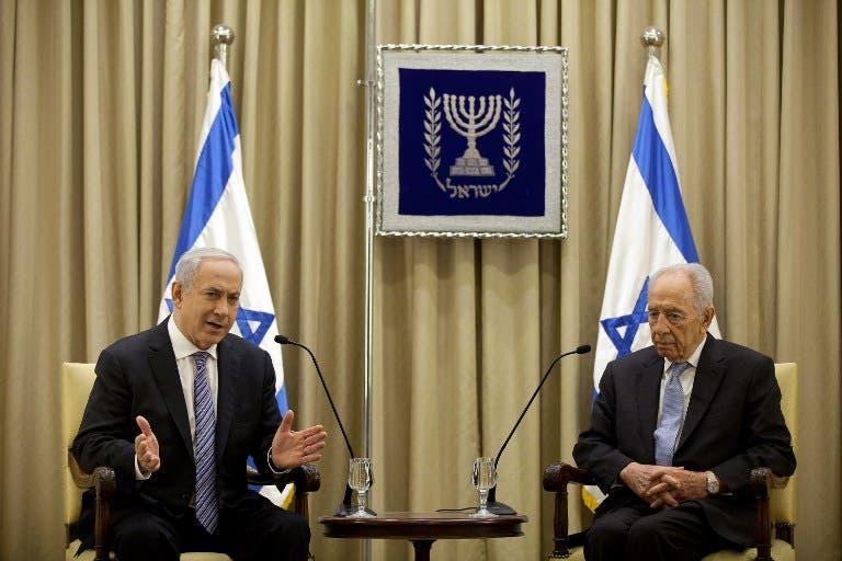 Prime Minister Netanyahu (L) and President Shimon Peres.