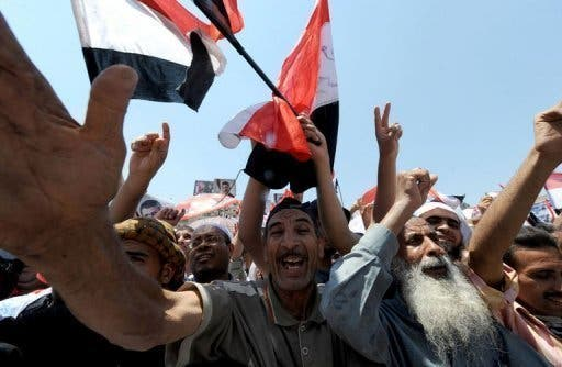Supporters of ousted Egyptian president Mohamed Morsi demonstrate after Friday prayers in Cairo on July 26, 2013 (AFP)