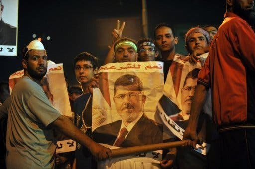 Supporters of ousted president Mohamed Morsi protest in Cairo on July 30, 2013 (AFP)