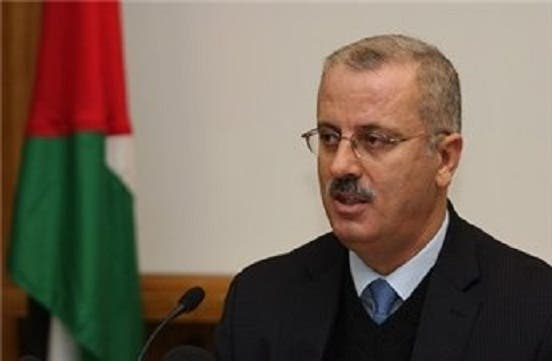 Rami Hamdallah, interim Palestinian Prime Minister, and his cabinet will be sworn in in Ramallah on Thursday in front on Mahmoud Abbas. (AFP/File)