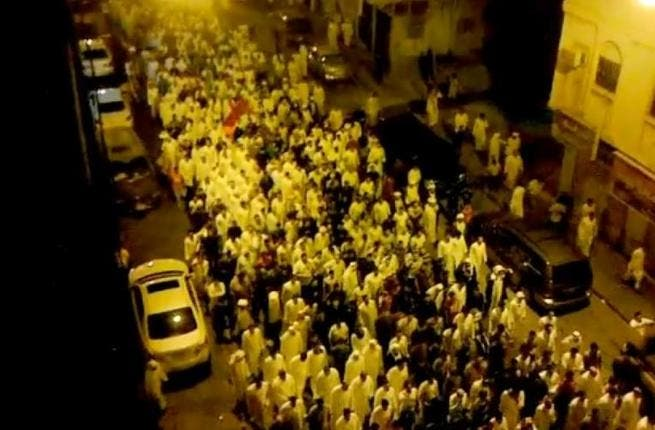Unverifiable video still of protestors mourning the death in Qatif