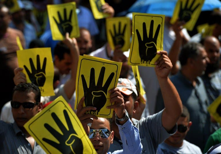 11 Muslim Brotherhood members have been sentenced to life in prison for allegedly inciting violence towards anti-Morsi protesters in August. (AFP/File)