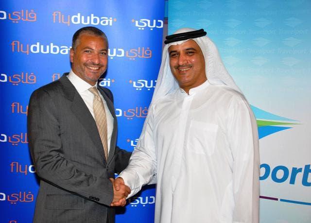 Ghaith Al Ghaith, CEO of flydubai shaking hands with Rabih Saab, President and Managing Director of Travelport at ATM 2011