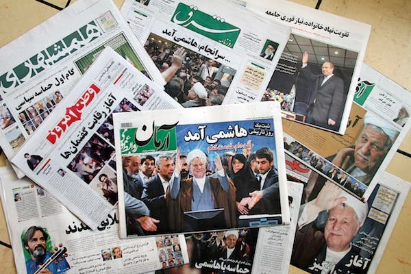 Iranian newspapers show their support of Rafsanjani, before his disqualification by the GC. AFP Photo
