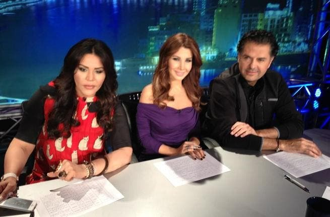 Ragheb (R) sits with Ahlam (L) and Nancy backstage