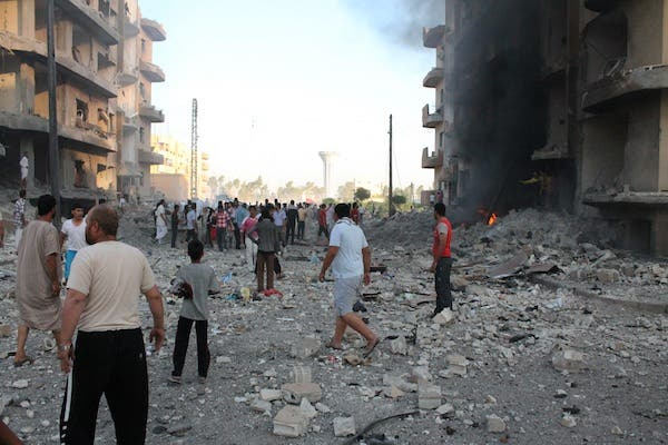 Rubble and debris litter the street following an explosion in the northern Syrian city of Raqqa, early on August 7, 2013. (AFP)