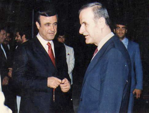 Rifaat al-Assad (left) and Hafez al-Assad (right) (Source: Wikimedia, public commons)