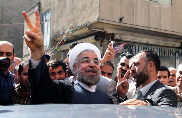 Is the moderate, Western-thinking sentiment behind Rouhani's tweets all a facade? (AFP/File)