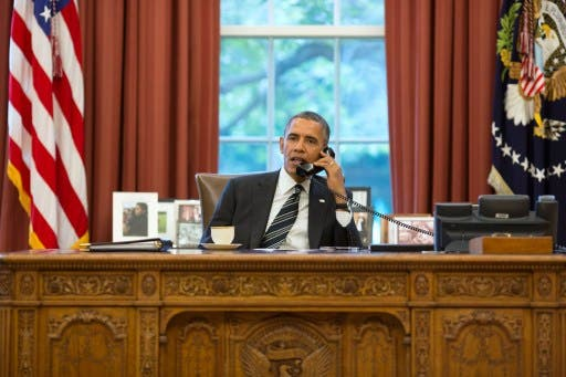 This official White House photograph released on September 27, 2013 shows President Barack Obama talks with President Hassan Rouhani of Iran during a phone call. A historic day - but what is driving Rouhani's desire to boost Iran's relations with the US? (AFP)