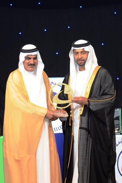 Sheikh Hamdan bin Zayed presents the award to Ali Al Jarwan, ADMA-OPCO CEO