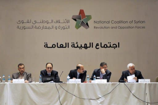 (From L-R) Member of the General Secretariat of the Syrian National Council Mohammad Farouk Tayfour, General Secretary of the Syrian National Council Bader Jamous, chief of the Syrian National Council (SNC) Ahmad Jarba (C), and member of the coalition Monzer Akbik attend a meeting of the National Coalition of Syrian Revolution and Opposition forces on September 13, 2013, in Istanbul. (AFP)