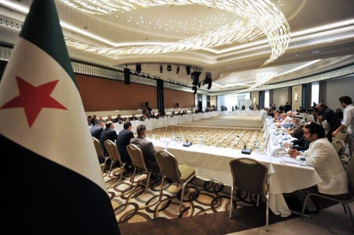 Ahmad Tumeh was elected provisional PM of the SNC on Saturday. Here, members of Syrian National coalition (SNC) attend a meeting of the National Coalition of Syrian Revolution and Opposition forces on September 13, 2013, in Istanbul. (AFP)