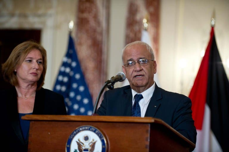 Chief Palestinian negotiator Saeb Erakat speaks to the press with Israel's chief negotiator and Justice Minister Tzipi Livni at the State Department in Washington DC on July 30, 2013. (AFP)