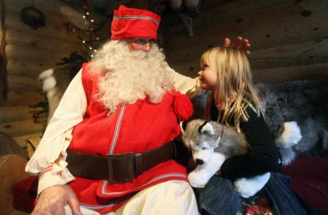 Santa Claus is happy delivering gifts to homes in Dubai
