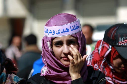 A Yemeni girl takes part in a gathering in support with Saudi young woman Huda al-Niran outside the courthouse during her trial on November 24, 2013 in the capital Sanaa. (AFP)