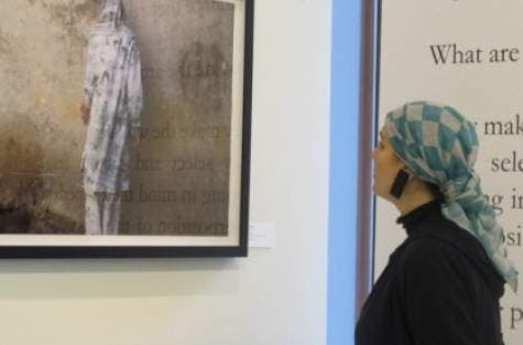 Saudi Princess Reem Al Faisal looks at a picture taken by a photographer exhibiting his work in her gallery in Dubai. (Jumana Al Tamimi/Gulf News)