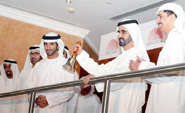 Sheikh Mohammed rings the bell at the Dubai Financial Market on Wednesday. (Image courtesy: WAM news agency)