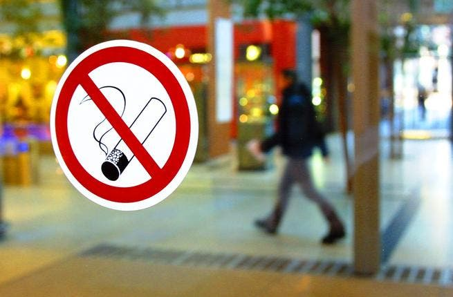 is the smoking ban detrimental to Abu Dhabi's businesses?