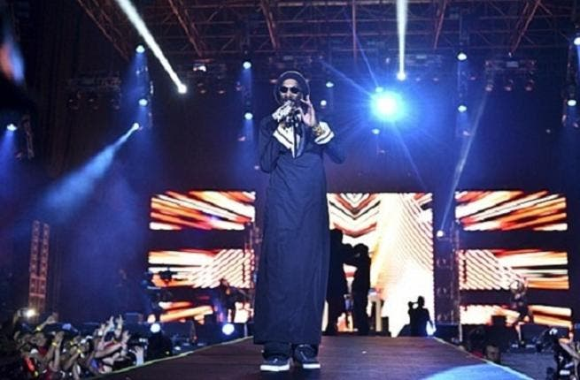 Snoop is seen wearing two thobes in his latest video
