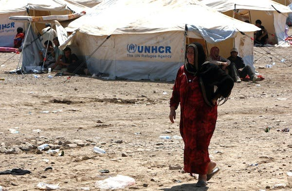 A Syrian-Kurdish woman walks at the Quru Gusik refugee camp, 20 kilometres east of the of Arbil, the capital of the autonomous Kurdish region of northern Iraq, on August 17, 2013. (AFP)