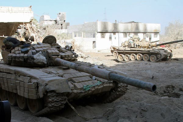 Syrian army tanks are seen deployed in the Jobar neighbourhood of Damascus on August 24, 2013. (AFP)