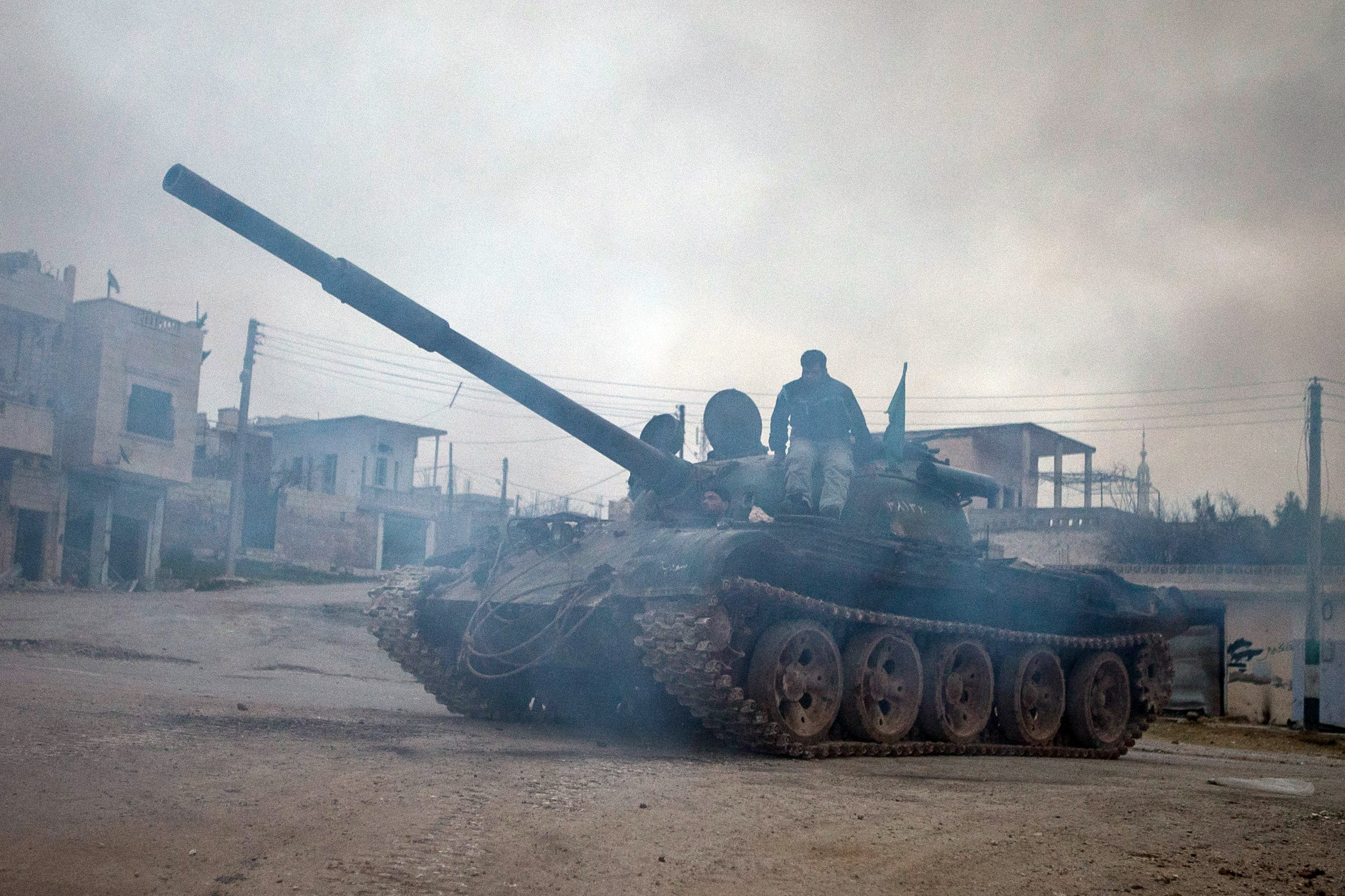 Syrian rebels drive a T-72 tank, captured from government forces two months ago, in the village of Kfarruma in the flashpoint Syrian province of Idlib near the border with Turkey, on Monday (AFP Photo/Daniel Leal-Olivas)