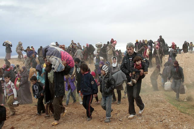 Amid fresh claims of a chemical weapons attack in the rebel-held town of Nabek on Friday, hundreds of Syrian refugees entered into Jordan this weekend. Here, refugees are seen entering Jordan via the northern border last week. (Photo courtesy of The Jordan Times/Nader Daoud)