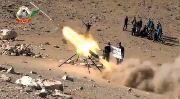 An image grab taken from a video uploaded on YouTube on May 29, 2013 allegedly shows members of the Al-Tawhid brigade firing missiles from Syria towards the Lebanese town of Hermel, a few kilometres from Baalbek in the Bekaa valley. (AFP)