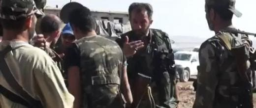 A screenshot of an Iranian military adviser talking to Syrian army troops (Al Bawaba/YouTube)