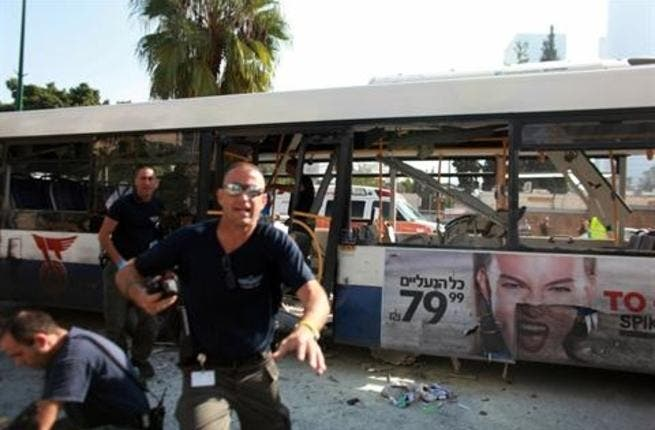 Israeli police gather after a blast ripped through a bus near the defence ministry in Tel Aviv on November 21, 2012. AFP PHOTO / DANIEL BAR-ON