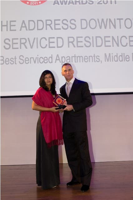 Seema Pande, Area Director of Sales & Marketing, receiving the award on behalf of The Address