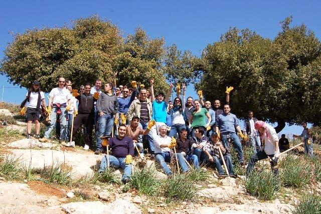 Employees of Four Seasons Hotel Amman planting trees